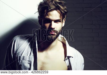 Handsome Man, Muscular Macho Athlete Bodybuilder In Unbutton Shirt With Muscle Torso