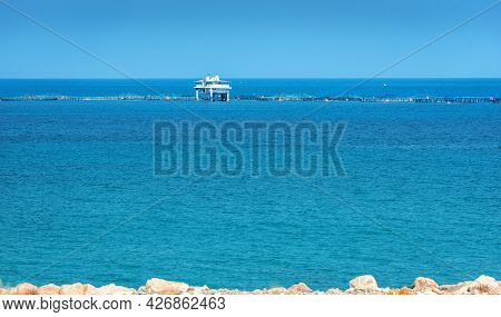 Fish Farm Growing Sea Bass And Dorado Fish In Mediterranean Sea, View From The Shore At Limassol Car