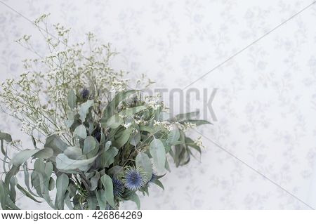 Dry Bouquet Of Flowers And Herbs Of Green Shades In A Vase Against The Background Of The Wall, Copys