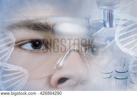 Dna Molecule Research Study Concept. The Scientist Looks At The Dna Molecules.