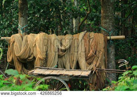 Fishermen's Fishing Nets And A Van Carrying Nets
