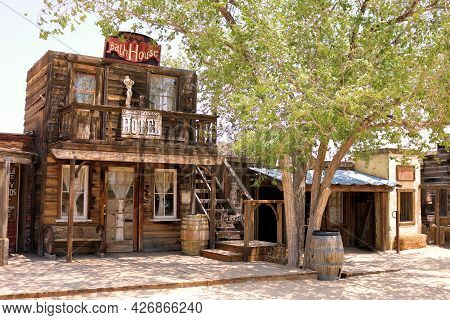 July 14, 2021 In Pioneertown, Ca:  Vintage Preserved Wooden Building On A Historical Boardwalk Besid