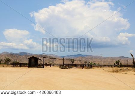 Equestrian Ranch On A High Desert Plateau Surrounded By Joshua Trees With Monsoon Thunderstorms Duri