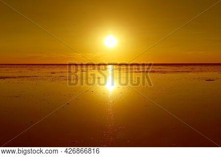 Reflection Of The Bright Sun On The Flooding Salt Flats, The Iconic Mirror Effect At Salar De Uyuni