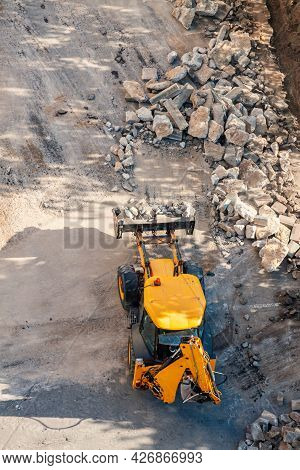 Wheel Loader Excavator Construction Site With Rubble Road