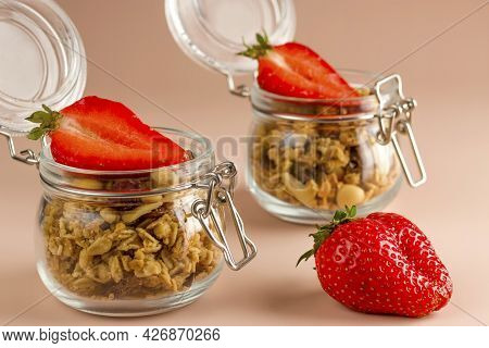 Muesli With Fruits And Strawberries On A Pink Background. Granola Healthy Food Dessert Snack. Keepin