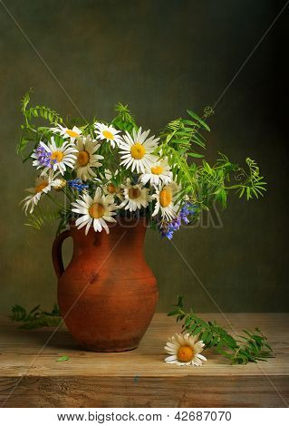 Still life with a bouquet of daisies poster