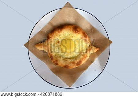 Khachapuri-ajarian Open Pie With Homemade Cheese And Egg Close-up On A Plate. Georgian Traditional C