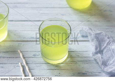 Healthy Dietary Milk Whey In Glasses On Light Blue Background, Selective Focus