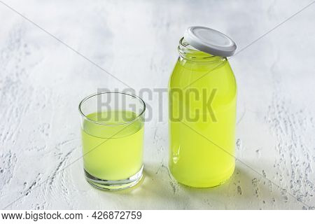 Healthy Dietary Milk Whey In Glass And Bottle On Light Blue Background, Selective Focus