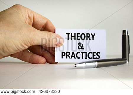 Theory And Practice Symbol. White Paper With Words 'theory And Practice' In Businessman Hand, Metall