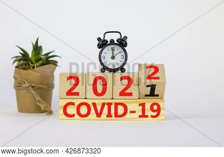 Covid-19 Pandemic In 2022 Symbol. Turned A Wooden Cube And Changed Words 'covid-19 2021' To 'covid-1