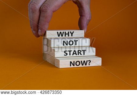Why Not Start Now Symbol. Wooden Blocks With Words 'why Not Start Now'. Beautiful Orange Background.