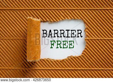 Barrier Free Symbol. Words 'barrier Free' Appearing Behind Torn Brown Paper. Beautiful Brown Backgro