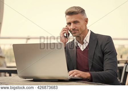 Sales Manager Talk To Client On Mobile Phone Using Computer Technology For Selling And Buying Online