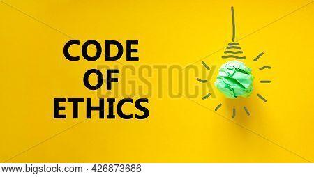 Code Of Ethics Symbol. Green Shining Light Bulb Icon. Words 'code Of Ethics'. Beautiful Yellow Backg