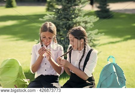 Going To Beauty School. Happy Girl Children Plait Hair Outdoors. Hairstylist Education. Hairdressing