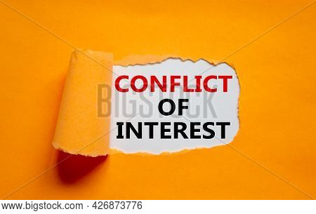 Conflict Of Interest Symbol. Words 'conflict Of Interest' Appearing Behind Torn Orange Paper. Beauti