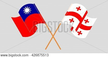 Crossed And Waving Flags Of Georgia And Taiwan