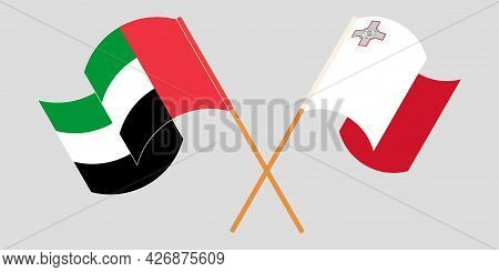 Crossed And Waving Flags Of Malta And United Arab Emirates