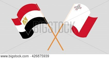 Crossed And Waving Flags Of Malta And Egypt
