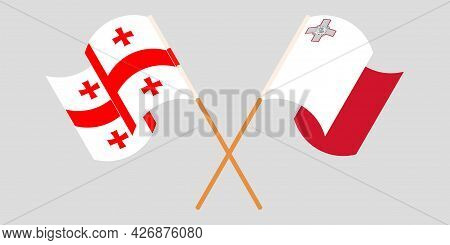 Crossed And Waving Flags Of Malta And Georgia