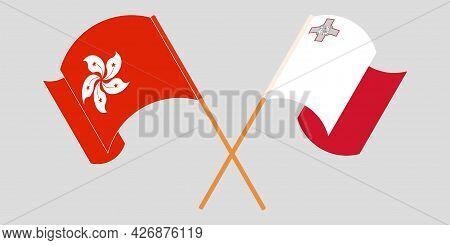 Crossed And Waving Flags Of Malta And Hong Kong