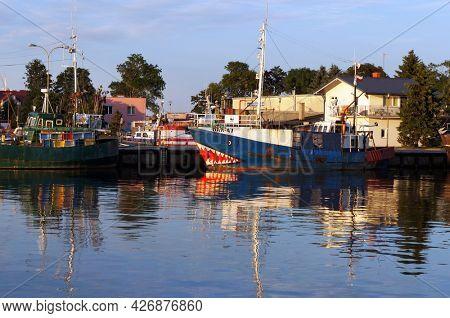 Darlowko, Poland - July 24, 2015: Fishing boats on river Wieprza in Darlowko - popular resort at Baltic Sea.
