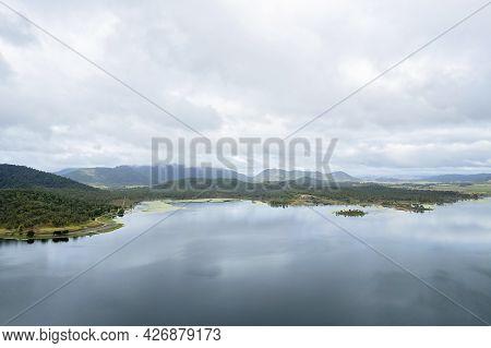 Calm Water And Cloud Reflections Across Kinchant Dam, Queensland, Australia