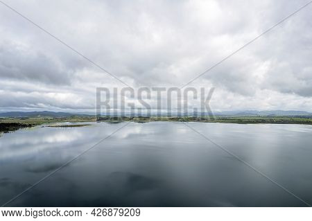 Cloud Reflections And Calm Water Across Kinchant Dam, Queensland, Australia