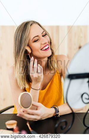 Beauty blogger applying contour to her cheek