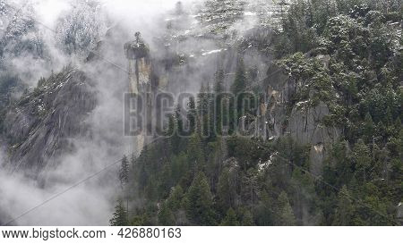 Winter Shot Of Mist Swirling Around Cliffs And Trees At Yosemite Valley