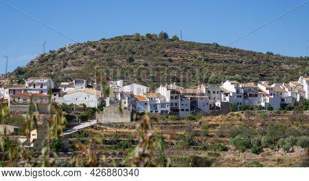 Tarbena,terraced Hillside Outside The Town With Row Of Characteristically Whitewashed Houses With Te