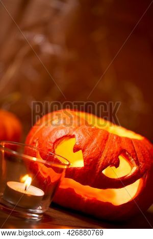 Halloween pumpkin and small candles