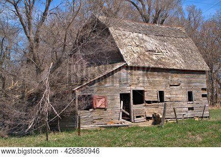 Sun Bleached Wood Of An Old Wood Farm Barn