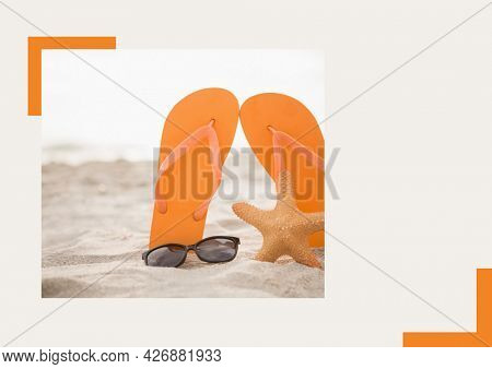 Photograph of flip flops, sunglasses and starfish at the beach against grey background. summer holiday and vacation concept