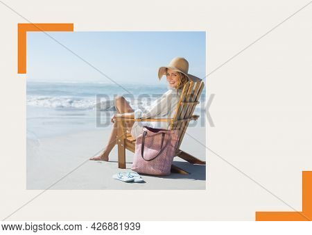 Photograph of caucasian woman sitting on a chair smiling at the beach against grey background. summer holiday and vacation concept