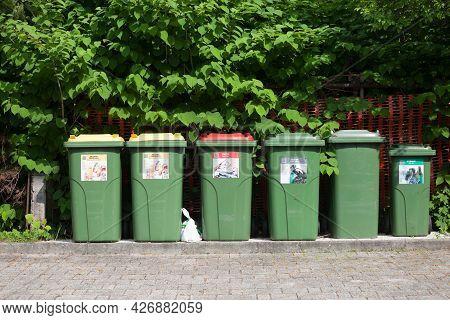 Bled, Slovenia - June 12, 2021: Trash Kind With Distinctive Color Codes Designed To Separate Waste A