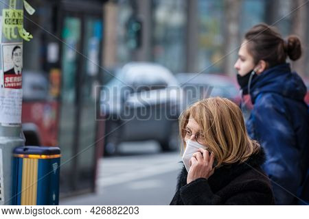 Belgrade, Serbia - March 20, 2021: Old Senior Woman Wearing A Respiratory Facemask, Calling Using A