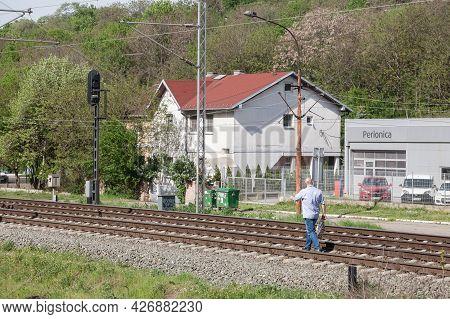 Belgrade, Serbia - May 2, 2021: Man Walking Alone On A Railway Track Of Serbian Railways In Belgrade