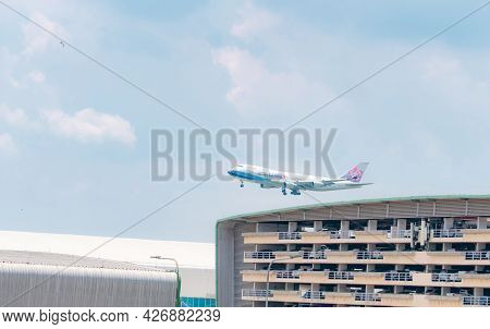 Samut Prakan, Thailand-may 15, 2021 : China Airlines Cargo Plane Flying Above Multi-story Car Park B