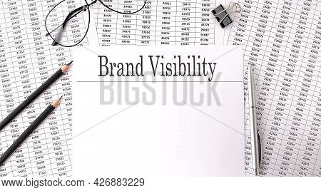 Paper With Brand Visibility On Table On Charts