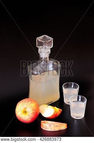 Calvados, Spirits And Ripe Apples On A Black Background.