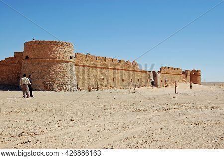Abu Nujaym, Libya - April 1, 2006:  Visitors Exploring The Desert Fortification In Abu Nujaym In Lib