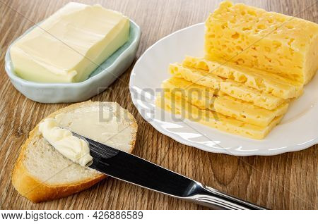 Piece Of Butter In Spotted Light-blue Plate, Table Knife On Slice Of Bread, Slices Of Yellow Cheese