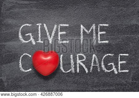 Give Me Courage Slogan Written On Chalkboard With Red Heart Symbol