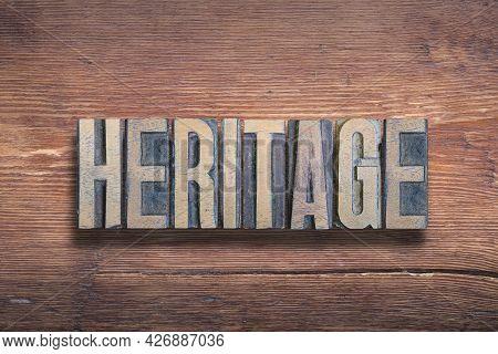 Heritage Word Combined On Vintage Varnished Wooden Surface