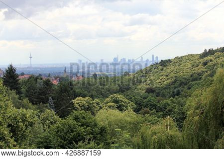 The Skyline Of Frankfurt, Hessen, Germany Behind A Small Forest
