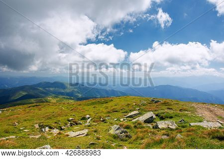 Mountain Landscape On A Sunny Day. Beautiful Nature Background. Gorgeous Cloudscape Above The Mounta