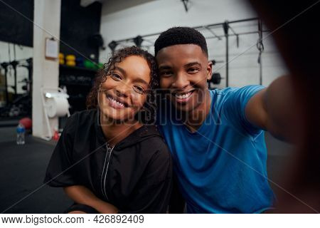 Mixed Race Friends Taking A Photo Together In The Gym. Happy African American Male And Female Taking